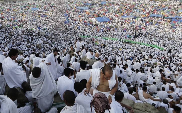 Muslim pilgrims pray on a rocky hill called the Mountain of Mercy, on the Plain of Arafat near the holy city of Mecca, Saudi Arabia, Thursday, Oct. 25, 2012. Saudi authorities say around 3.4 million pilgrims — some 1.7 million of them from abroad — have arrived in the holy cities of Mecca and Medina for this year's pilgrimage. (AP Photo/Hassan Ammar)