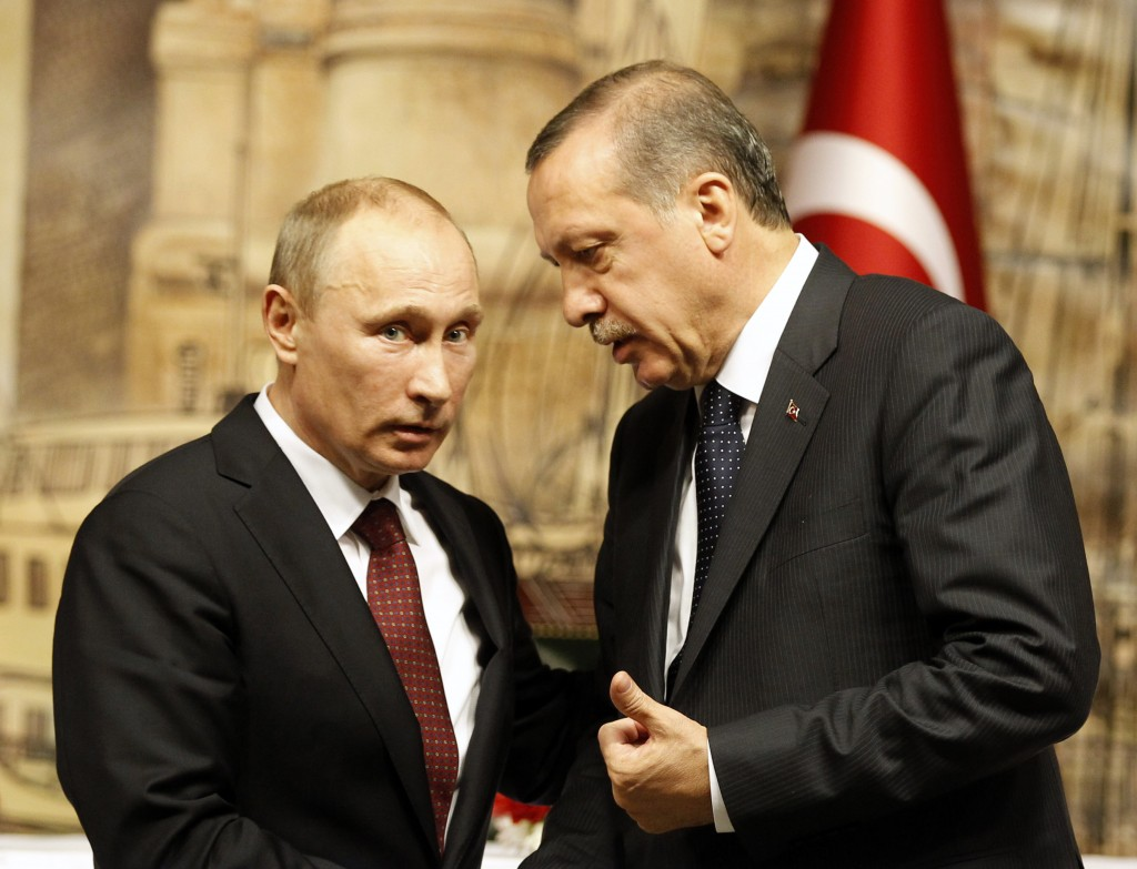 Russia's President Putin talks with Turkey's Prime Minister Erdogan after their news conference